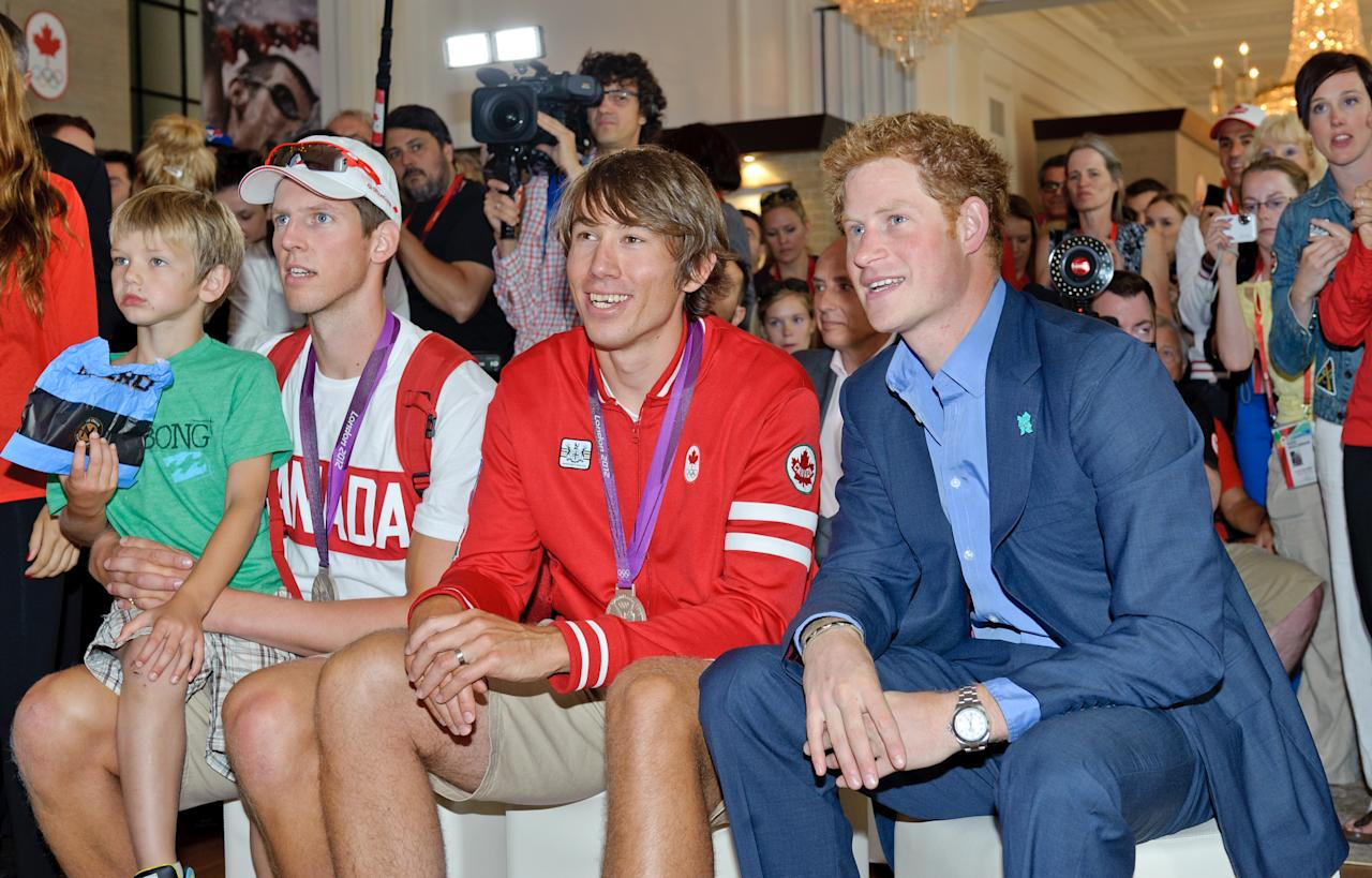 Prince Harry watches the final of the women's 8 rowing competition with Canadian Olympians, families, officials and Olympic Committee members at Canada Olympic House, London, Thursday Aug. 2, 2012. (Canadian Olympic Committee Photo)