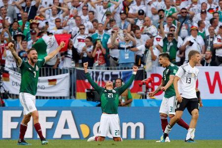 Soccer Football - World Cup - Group F - Germany vs Mexico - Luzhniki Stadium, Moscow, Russia - June 17, 2018 Mexico's Edson Alvarez, Miguel Layun and Carlos Salcedo celebrate at full time as Germany's Thomas Muller looks dejected REUTERS/Maxim Shemetov
