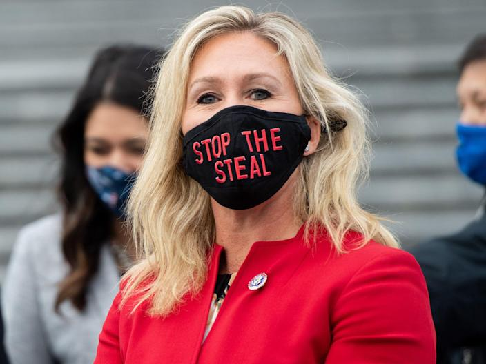 "<p>US Representative Marjorie Taylor Greene, Republican of Georgia, wears a ""Stop the Steal"" mask on the steps of the US Capitol in Washington, DC</p> (AFP via Getty Images)"