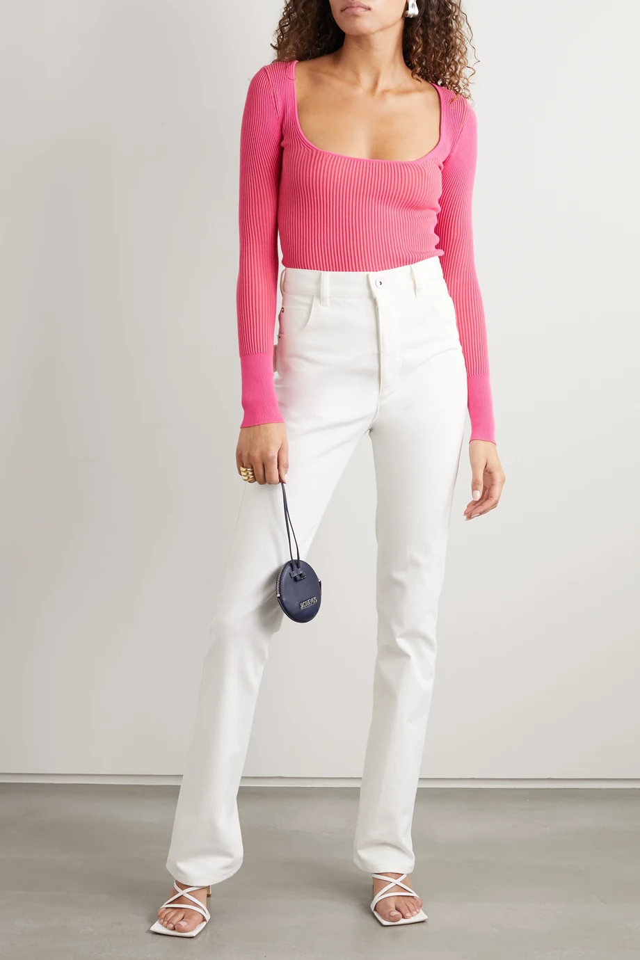 """Who would we be if we didn't supply you with ample options for <a href=""""https://www.net-a-porter.com/en-us/shop/product/jacquemus/loiza-ribbed-knit-top/1215922"""" rel=""""nofollow noopener"""" target=""""_blank"""" data-ylk=""""slk:under-$130 Jacquemus"""" class=""""link rapid-noclick-resp"""">under-$130 Jacquemus</a>? <br> <br> <strong>Jacquemus</strong> Ribbed Knit Sweater, $, available at <a href=""""https://go.skimresources.com/?id=30283X879131&url=https%3A%2F%2Fwww.net-a-porter.com%2Fen-us%2Fshop%2Fproduct%2Fjacquemus%2Fribbed-knit-sweater%2F1215931"""" rel=""""nofollow noopener"""" target=""""_blank"""" data-ylk=""""slk:Net-A-Porter"""" class=""""link rapid-noclick-resp"""">Net-A-Porter</a>"""