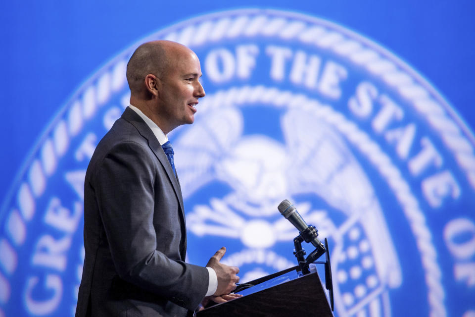 Utah Gov. Spencer Cox speaks during his monthly news conference on March 18, 2021, in Salt Lake City. Cox has signed a law requiring biological fathers to pay half of a woman's out-of-pocket pregnancy costs. (Spenser Heaps/The Deseret News via AP, Pool, File)