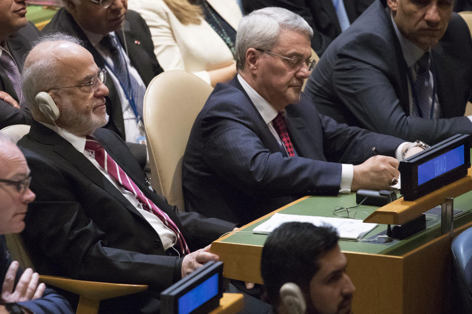 <p>Iraqi Foreign Minister Ibrahim al-Jaafari, left, listens as President Trump speaks during the 72nd session of the United Nations General Assembly at U.N. headquarters, Tuesday, Sept. 19, 2017. (Photo: Mary Altaffer/AP) </p>