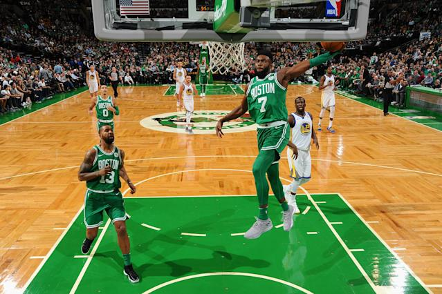 The Celtics' Jaylen Brown, who scored a team-high 22 points, dunks against Golden State on Thursday night. (Getty Images)