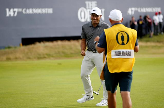 Italy's Francesco Molinari reacts with his caddie after a birdie putt on the 18th during the final round of the British Open. (REUTERS)