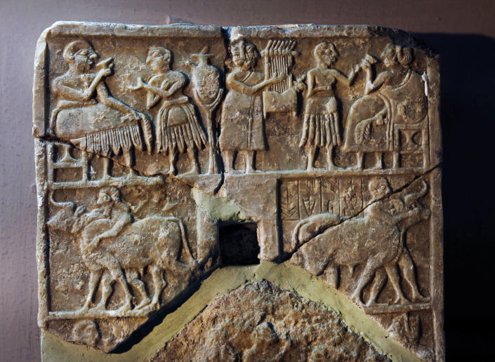 A recovered stone is displayed at the Iraqi National Museum in Baghdad, Iraq, Monday, April 1, 2013. Tens of thousands of artifacts chronicling some 7,000 years of civilization in Mesopotamia are believed to have been looted from Iraq in the chaos which followed the the US-led invasion in 2003. Despite international efforts to track items down, fewer than half of the artifacts have so far been retrieved. (AP Photo/Hadi Mizban)