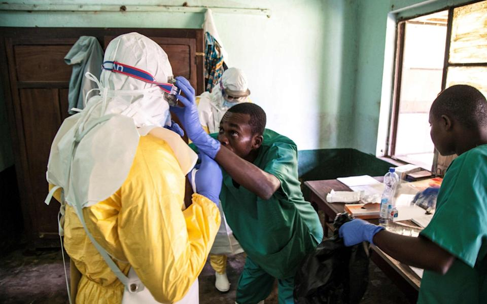 Health workers wear protective equipment as they prepare to attend to suspected Ebola patients at Bikoro Hospital, Equateur province, DRC - ARK NAFTALIN/AFP/Getty Images