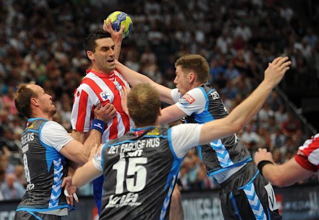 Madrid's Kiril Lazarov (C) vies with players of Copenhagen during the Handball Champions League EHF Final Four semi final match BM Atletico Madrid vs AG Kobenhavn on May 26, 2012 in Cologne, western Germany. Madrid won the match 25-23. AFP PHOTO JONAS GUETTLER GERMANY OUTJONAS GUETTLER/AFP/GettyImages