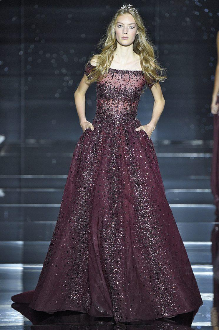 A model walks the runway in the dress Adele is wearing on tour. (Photo by Victor VIRGILE/Gamma-Rapho via Getty Images)