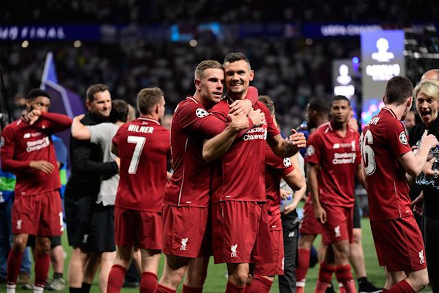 Liverpool's English midfielder Jordan Henderson (L) and Liverpool's Croatian defender Dejan Lovren celebrate. (Photo by JAVIER SORIANO / AFP)