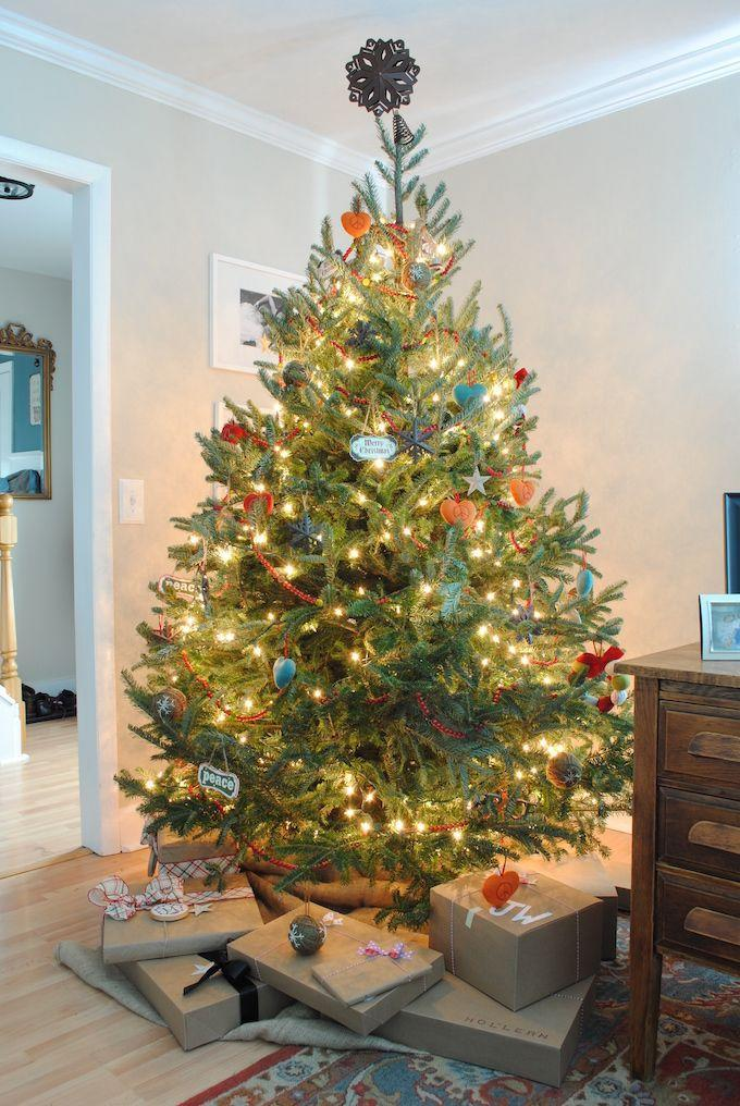 "<p>Use every inch of a short and stout tree by hanging ornaments in a variety of sizes. </p><p>See more at <a href=""http://www.theartofmoseying.com/12-days-of-christmas-christmas-living-room/"" rel=""nofollow noopener"" target=""_blank"" data-ylk=""slk:The Art of Moseying"" class=""link rapid-noclick-resp"">The Art of Moseying</a>.</p><p><a class=""link rapid-noclick-resp"" href=""https://www.amazon.com/Kurt-Adler-9-Foot-Burgundy-Garland/dp/B00656O1U8/?tag=syn-yahoo-20&ascsubtag=%5Bartid%7C10057.g.505%5Bsrc%7Cyahoo-us"" rel=""nofollow noopener"" target=""_blank"" data-ylk=""slk:SHOP GARLAND"">SHOP GARLAND</a> <em><strong>Red Bead Garland, $10</strong></em></p>"