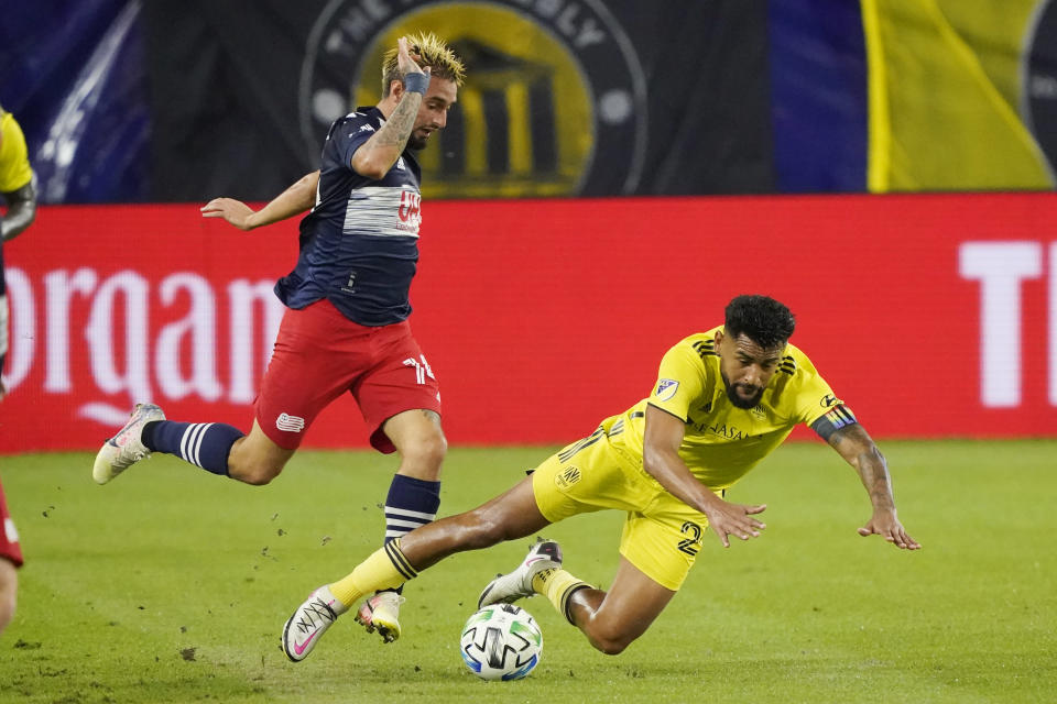 New England Revolution forward Diego Fagundez, left, and Nashville SC midfielder Anibal Godoy, right, collide during the first half of an MLS soccer match Friday, Oct. 23, 2020, in Nashville, Tenn. (AP Photo/Mark Humphrey)