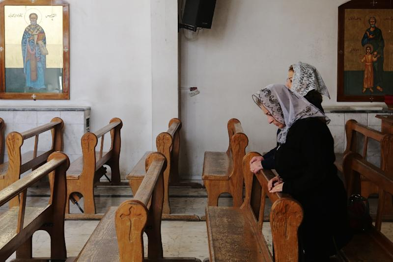 Displaced Assyrians, one the world's oldest Christian groups, take part in a prayer at the Ibrahim-al Khalil Melkite Greek Catholic church in the outskirts of Damascus on March 1, 2015