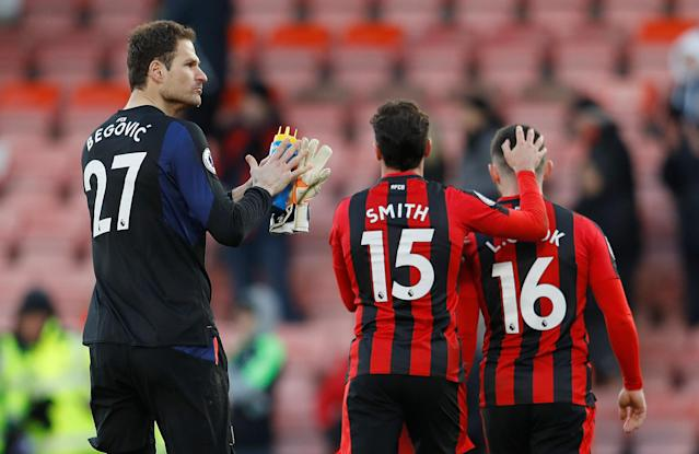 """Soccer Football - Premier League - AFC Bournemouth vs Newcastle United - Vitality Stadium, Bournemouth, Britain - February 24, 2018 (L - R) Bournemouth's Asmir Begovic, Adam Smith and Lewis Cook after the match REUTERS/Peter Nicholls EDITORIAL USE ONLY. No use with unauthorized audio, video, data, fixture lists, club/league logos or """"live"""" services. Online in-match use limited to 75 images, no video emulation. No use in betting, games or single club/league/player publications. Please contact your account representative for further details."""