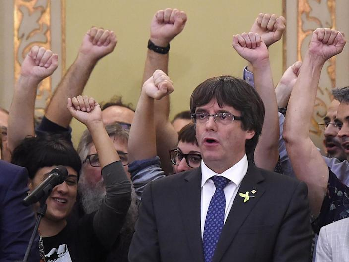 Catalan president Carles Puigdemont sings the Catalan anthem after parliamentary session last week (AFP/Getty Images)