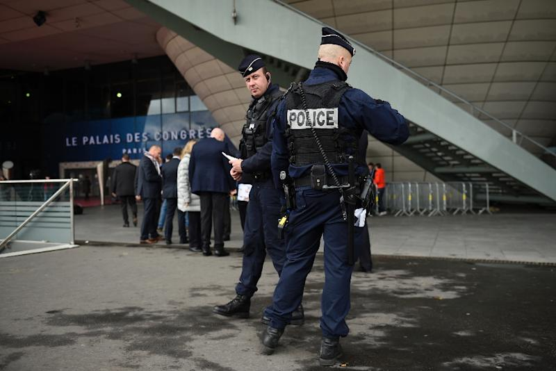Police outside the Palais des Congres in Paris on December 12, 2015, ahead of the draw for the Euro 2016 finals (AFP Photo/Franck Fife)