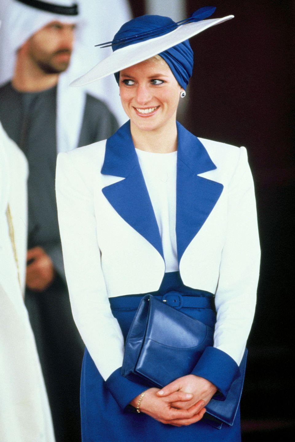 <p>In a suit by Catherine Walker and turban hat by Philip Somerville in Dubai. </p>