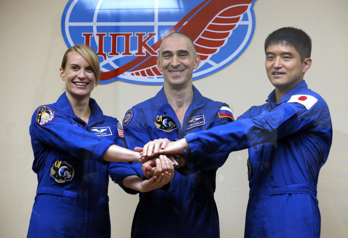 <p>U.S. astronaut Kate Rubins, left, Russian cosmonaut Anatoly Ivanishin, centre, and Japan astronaut Takuya Onishi, members of the main crew to the International Space Station (ISS), pose after a news conference in Russian leased Baikonur cosmodrome, Kazakhstan, Wednesday, July 6, 2016. Start of the new Soyuz mission is scheduled on Thursday, July 7. (AP Photo/Dmitri Lovetsky) </p>