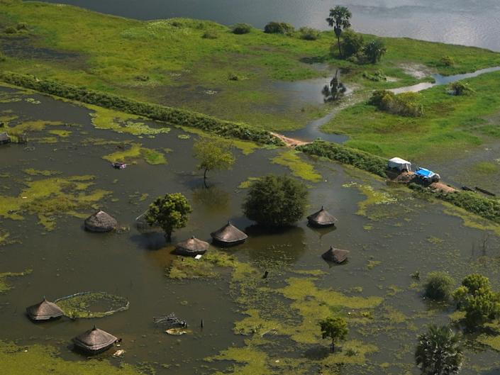 An aerial view shows flooded homes within a village after the River Nile broke the dykes in Jonglei State, South Sudan, October 5,2020.
