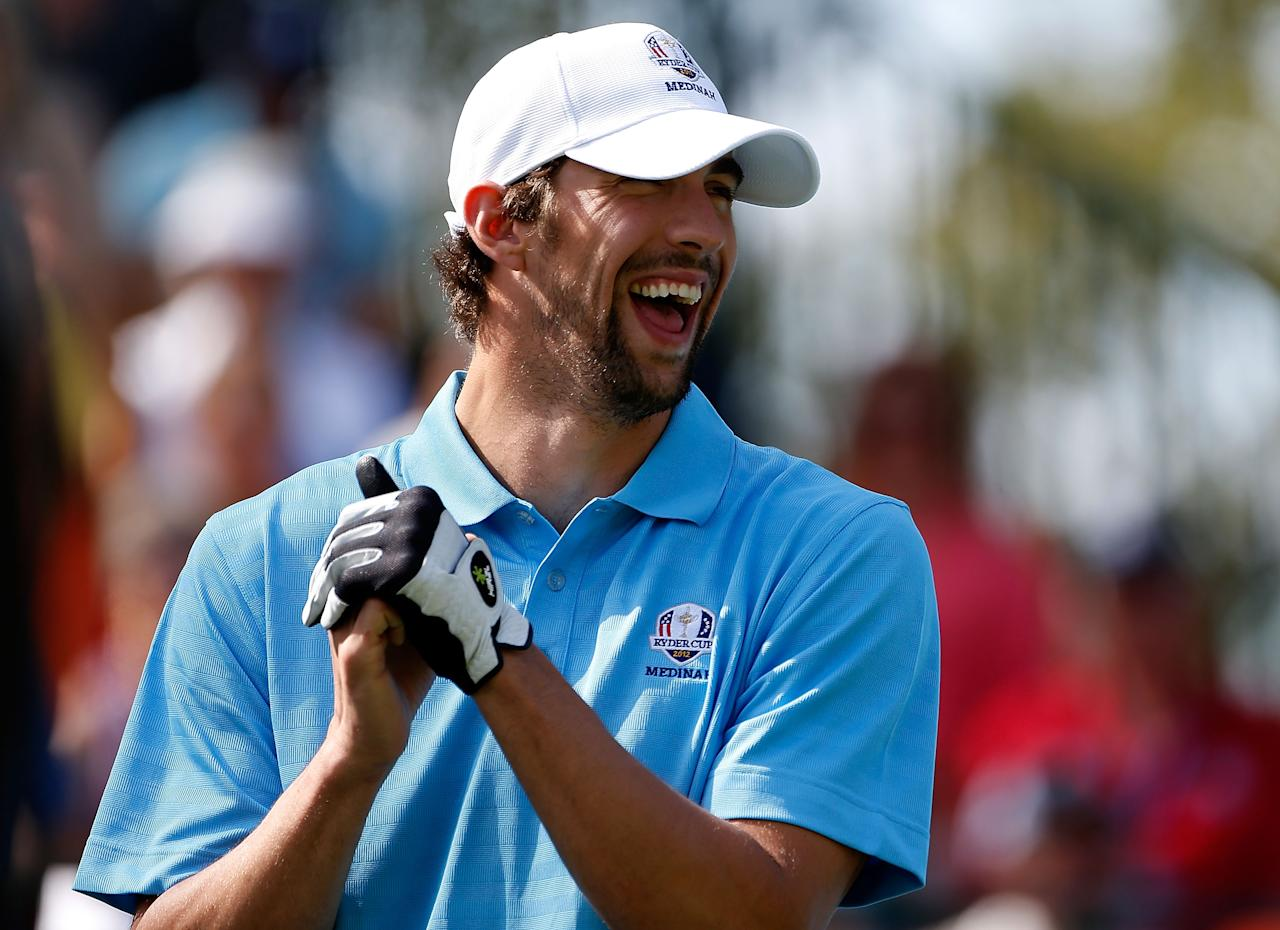MEDINAH, IL - SEPTEMBER 25:  Olympic champion Michael Phelps smiles on the first tee during the 2012 Ryder Cup Captains & Celebrity Scramble at Medinah Country Golf Club on September 25, 2012 in Medinah, Illinois.  (Photo by Jamie Squire/Getty Images)