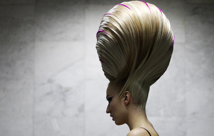 A model waits backstage before the Alternative Hair Show in Moscow?s Kremlin, September 28, 2011. (Photos: REUTERS/Denis Sinyakov