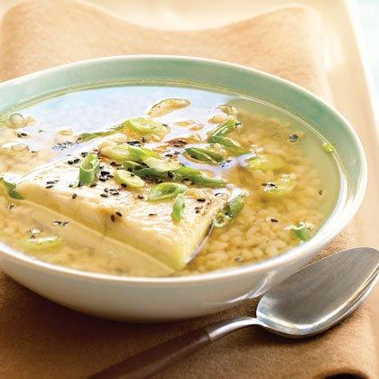 """<p>A simple broth of green tea poured over brown rice and fish makes an easy and healthful weeknight meal. Try shredded leftover chicken or diced tofu instead of black cod. We're partial to the extra-chewy texture of short-grain rice for this soup, but it's also a great way to use leftover rice of any sort. Garnishes and flavorings are equally flexible—cilantro, hot sauce, or nut oils would be fun to experiment with. Prep and Cook Time: about 1 1/4 hours. Notes: Black cod is also known as sablefish or butterfish. You can use leftover fish in this soup if you like. Nori (dried sheets of seaweed) is available at Asian markets and some supermarkets; genmaicha (green tea with roasted brown rice) is also available at Asian markets and specialty-food stores. </p><p><a href=""""https://www.myrecipes.com/recipe/green-tea-soup"""">Green Tea Soup Recipe</a></p>"""