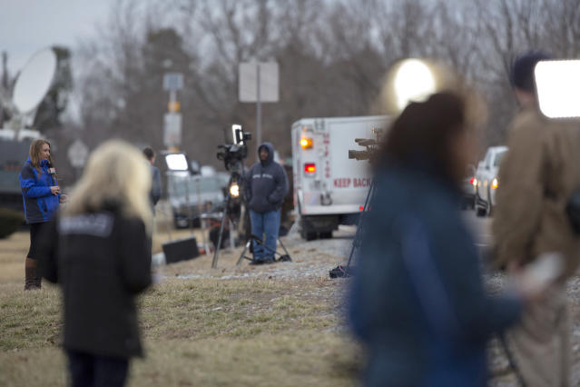 <p>Media outlets stage near an entrance to Marshall County High School after a deadly shooting at the school in Benton, Ky., Jan. 23, 2018. (Photo: Ryan Hermens/The Paducah Sun via AP) </p>