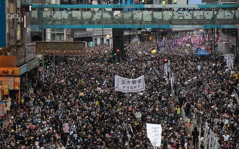 <span>An estimated one million people marched on New Year's Day</span> <span>Credit: Kyle Lam/Bloomberg </span>