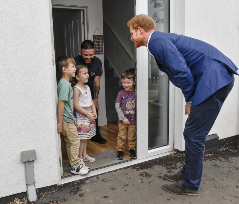 Likely telling Prince Harry he's allowed in the house.  (Pool via Getty Images)