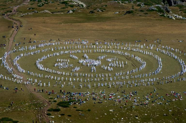 """The Universal White Brotherhood, reputed to have tens of thousands of members from the US to DR Congo, performed their """"paneurhythmy"""" ritual dance atop Rila Mountain to mark their """"spiritual"""" new year (AFP Photo/NIKOLAY DOYCHINOV)"""