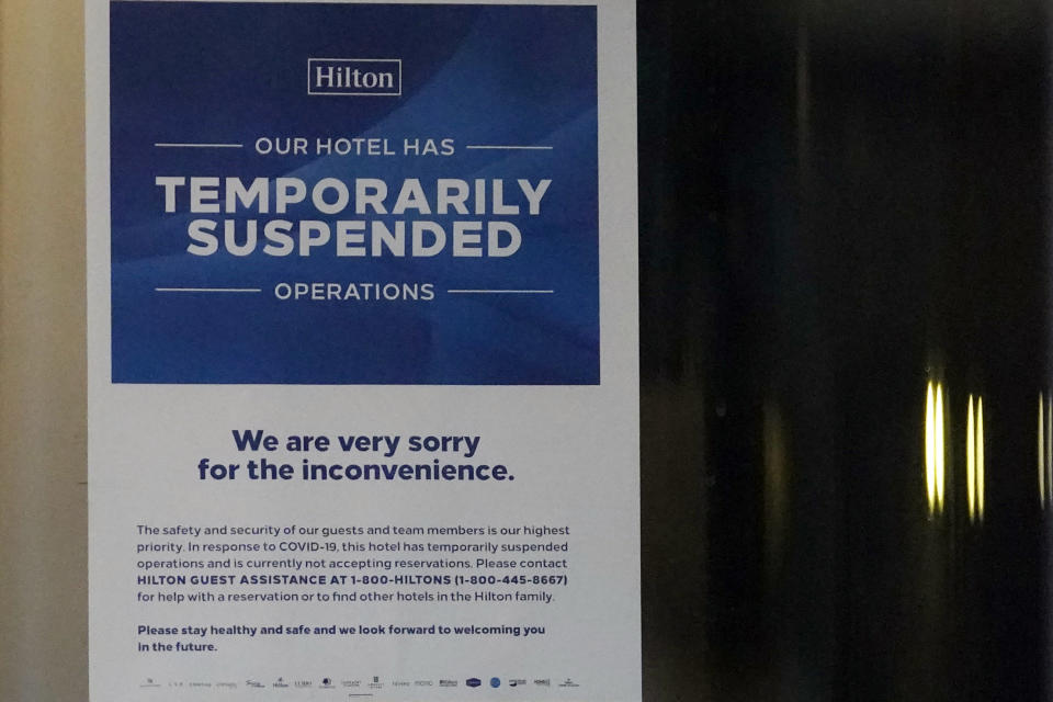 A information sign is seen at the Hilton Orrington/Evanston in Evanston, Ill., Saturday, Jan. 16, 2021. The Hilton Orrington/Evanston temporarily closed, citing coronavirus pandemic concerns. In Illinois alone, AHLA (American Hotel & Lodging Association) found about 26,000 hotel-related jobs have been lost due to the pandemic. (AP Photo/Nam Y. Huh)