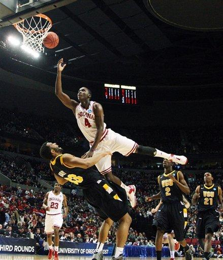 Indiana's Victor Oladipo (4) lays the ball up as Virginia Commonwealth's D.J. Haley (33) defends in the first half of an NCAA college basketball tournament third-round game in Portland, Ore., Saturday, March 17, 2012. (AP Photo/Rick Bowmer)