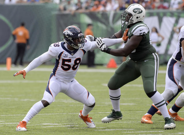 FILE- In this Sunday, Oct. 7, 2018, file photo, New York Jets offensive tackle Kelvin Beachum (68) blocks Denver Broncos linebacker Von Miller (58) during the first half of an NFL football game in East Rutherford, N.J. Miller hasn't had a sack for three weeks and the Broncos have lost all three games. (AP Photo/Bill Kostroun, File)