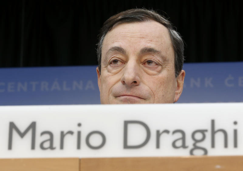 President of European Central Bank Mario Draghi speaks during a press conference following the meeting of the governing council in Frankfurt, Germany, Thursday, Feb. 6, 2014. The European Central Bank has left its benchmark interest rate unchanged, holding off on more stimulus despite weak economic growth and low inflation. The bank's 24-member governing council left the rate at 0.25 percent at a meeting in Frankfurt, Germany. Some analysts had thought the eurozone's monetary authority might cut the rate to 0.1 percent to try to boost growth more. (AP Photo/Michael Probst)