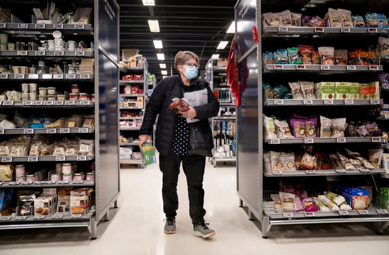 FILE PHOTO: A customer shops at a Foetex wearing a face mask amid the coronavirus disease (COVID-19) outbreak in Hilleroed