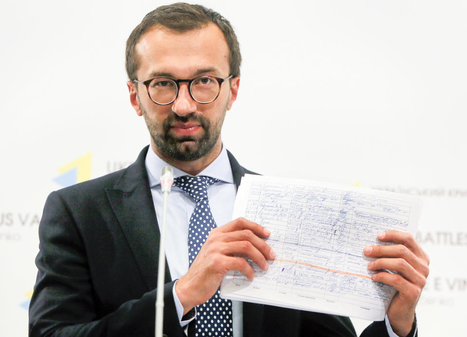 FILE - In this Aug. 19, 2016, file photo, Serhiy Leshchenko, a former investigative journalist turned lawmaker shows a copy one of the once-secret accounting documents of Ukraine's pro-Kremlin party that were released and purport to show payments earmarked for then-Donald Trump's campaign chairman Paul Manafort, during a news conference in Kiev, Ukraine. A firm headed by Manafort received more than $1.2 million in payments that correspond to entries in the handwritten ledger tied to a pro-Russian political party in Ukraine, according to financial records obtained by The Associated Press. The payments between 2007 and 2009 are the first evidence that Manafort's consulting firm received funds listed in the so-called Black Ledger, Ukrainian investigators have been investigating as evidence of off-the-books payments from the Ukrainian Party of Regions. (AP Photo/Efrem Lukatsky, File)