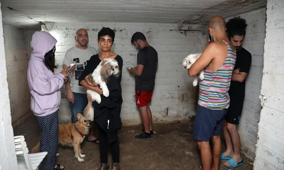 People take shelter in the basement of a building in the Israeli city of Tel Aviv after rockets were launched towards Israel from the Gaza Strip.