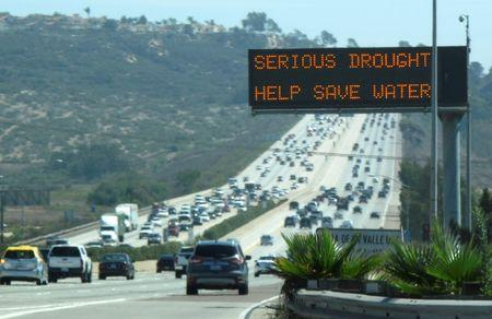 A digital traffic sign usually used for commuter travel information informs travelers southbound on interstate highway 5 to conserve water as they pass through Del Mar, California September 10, 2014. REUTERS/Mike Blake