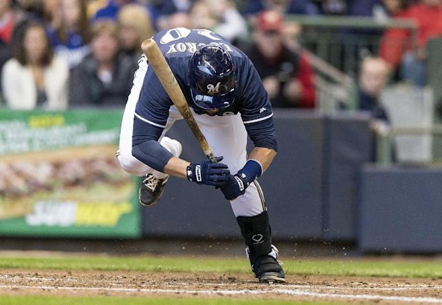 Milwaukee Brewers' Jonathan Lucroy is nearly hit by a pitch from the Kansas City Royals during the fifth inning of a spring exhibition baseball game, Saturday, March 29, 2014, in Milwaukee. (AP Photo/Tom Lynn)