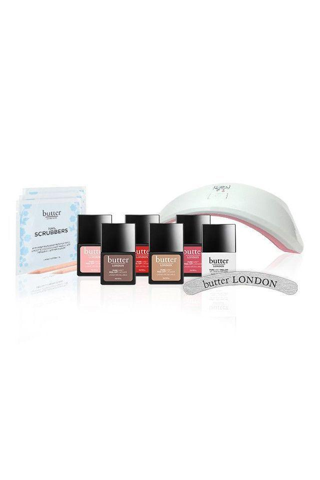 "<p><strong>Butter London</strong></p><p>butterlondon.com</p><p><strong>$69.00</strong></p><p><a href=""https://www.butterlondon.com/diy-gel-nails-manicure-bundle?gclid=Cj0KCQjwl4v4BRDaARIsAFjATPmkIUw8YdpX4TJgD5c4A9NfrKm8LsuUwO6i35ptvjMwmxLUhT3UUk0aAmWXEALw_wcB"" rel=""nofollow noopener"" target=""_blank"" data-ylk=""slk:SHOP IT"" class=""link rapid-noclick-resp"">SHOP IT</a></p><p>Butter London's kit focuses on a low-impact mani that still stays put. The quick-drying LED light means less dry time, exfoliating nail scrubbers remove old polish and imbue nail beds with Vitamin E, and the peel-off polish fills ridges and comes off easily—but only went you want it to. </p>"