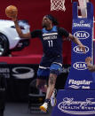 Minnesota Timberwolves center Naz Reid passes during the second half of an NBA basketball game against the Detroit Pistons, Tuesday, May 11, 2021, in Detroit. (AP Photo/Carlos Osorio)