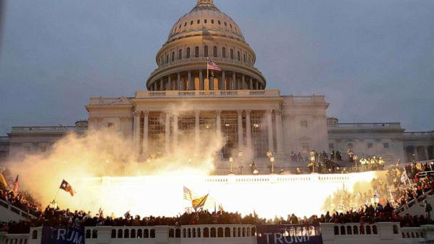 PHOTO: An explosion caused by a police munition is seen while supporters of U.S. President Donald Trump gather in front of the Capitol Building in Washington, Jan. 6, 2021.  (Leah Millis/Reuters)