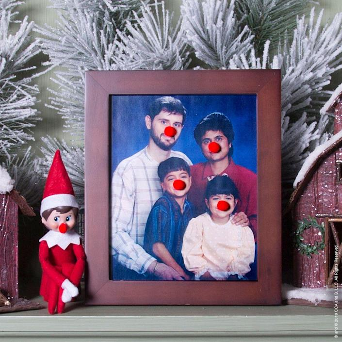 """<p>Clowns, Rudolph...whatever these noses remind you of, one thing's for sure: They'll have your entire family laughing soon enough.</p><p><strong>Get the tutorial at <a href=""""https://elfontheshelf.com/elf-ideas/clownin-around/"""" rel=""""nofollow noopener"""" target=""""_blank"""" data-ylk=""""slk:Elf on the Shelf"""" class=""""link rapid-noclick-resp"""">Elf on the Shelf</a>.</strong> </p>"""