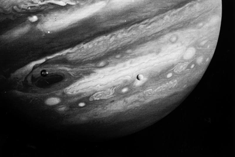 FILE - This Feb. 13, 1979 photo released by NASA's Jet Propulsion Laboratory on Feb. 22, 1979 shows the planet Jupiter and two of its moons, Io, left, and Europa, center. The Voyager 1 spacecraft was about 12.4 million miles from Jupiter when the photo was made. NASA said Tuesday, March 4, 2014 it is making preparations to plan a robotic mission to Jupiter's watery moon Europa, a place where astronomers speculate there might be life. The space agency set aside $15 million in its 2015 budget proposal to start planning a mission to Europa. No details were released but NASA chief financial officer Elizabeth Robinson said Tuesday that it would be launched in the mid-2020s. (AP Photo/NASA, Jet Propulsion Laboratory)