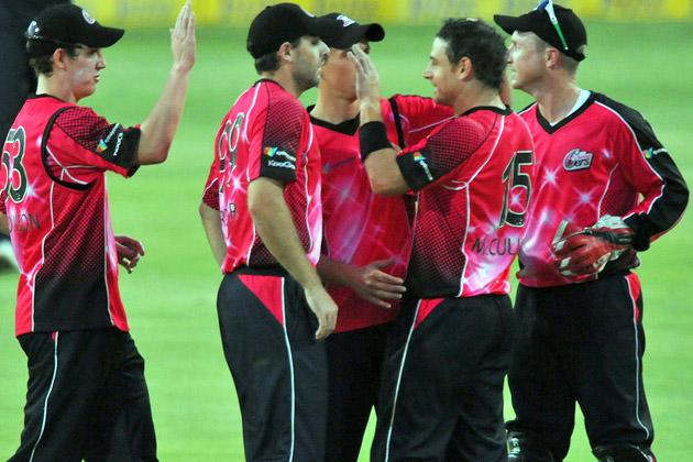 Nathan McCullum (2nd R) of the Sixers celebrates his 3rd wicket for 24 runs during the Karbonn Smart CLT20 Final match between bizhub Highveld Lions and Sydney Sixers at Bidvest Wanderers Stadium on October 28, 2012 in Johannesburg, South Africa. (Photo by Duif du Toit/Gallo Images/Getty Images)