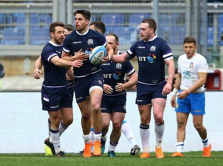 Rugby Union - Six Nations Championship - Italy vs Scotland - Stadio Olimpico, Rome, Italy - March 17, 2018 Scotland's Sean Maitland celebrates scoring their third try with team mates REUTERS/Alessandro Bianchi