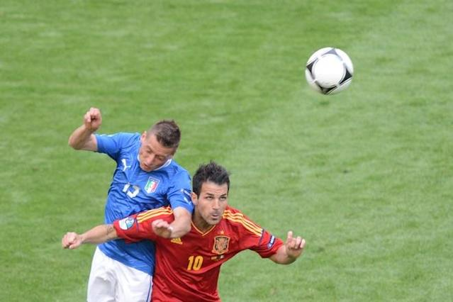Italian Italian midfielder Emanuele Giaccherini (L) vies with Spanish forward Cesc Fabregas during the Euro 2012 championships football match Spain vs Italy on June 10, 2012 at the Gdansk Arena. AFPPHOTO/ PATRIK STOLLARZPATRIK STOLLARZ/AFP/GettyImages