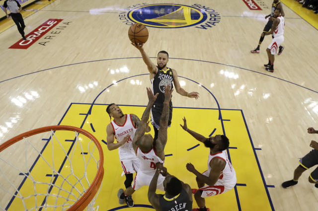 Golden State Warriors guard Stephen Curry, top, shoots against the Houston Rockets during the first half in Game 4 of the NBA basketball Western Conference Finals Tuesday, May 22, 2018, in Oakland, Calif. (AP Photo/Marcio Jose Sanchez, Pool)