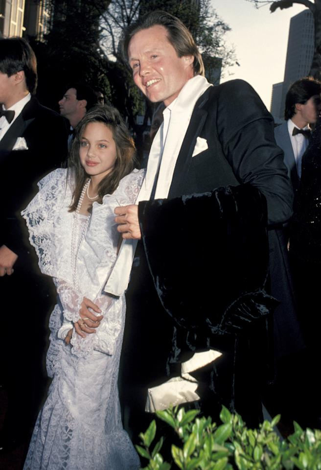 Angelina Jolie first graced the Academy Awards red carpet back in 1986 when she accompanied her father Jon Voight, who was a Best Actor nominee that year. At just nine-years-old, Jolie probably had little idea she would later win an Oscar, endure a seven-year rift with her father, stir up scandal with her brother and rule the arrivals as one half of Hollywood's most famous couple.