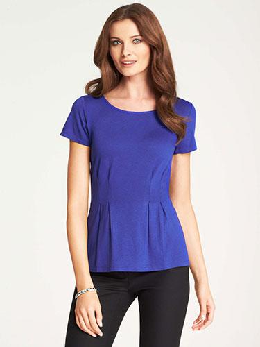 """<div class=""""caption-credit""""> Photo by: Courtesy of the Company</div><div class=""""caption-title"""">Peplum top</div>Your first thought might be that extra volume adds bulk, but that's not the case, says Thomson, who calls these shirts her """"go-to tummy cinchers."""" The key is to avoid ruffles that are too flared, which can overemphasize your butt instead of accentuating the curves in that area. Wear it without or without sleeves, depending on the season and your feelings about your arms. """"Either way, when the cinching happens in that perfect spot just below the waistline, it can really flatter your silhouette,"""" says Thomson. <br> <br> Jersey Peplum Top, $49; Ann Taylor. <br> <b><br></b> <ul>  <li>  <b><a rel=""""nofollow"""" target="""""""" href=""""http://www.redbookmag.com/beauty-fashion/tips-advice/flattering-jeans-for-every-body-type?link=jeans&dom=yah_life&src=syn&con=blog_redbook&mag=rbk"""">The Best Jeans for Your Body</a></b>  </li>  <li>  <a rel=""""nofollow"""" target="""""""" href=""""http://www.redbookmag.com/beauty-fashion/tips-advice/fall-bags?link=fallbags&dom=yah_life&src=syn&con=blog_redbook&mag=rbk""""><b>83 Fall Handbags Under $100</b></a>  </li> </ul>"""