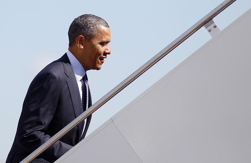 President Barack Obama boards Air Force One, Wednesday, June 6, 2012, at Andrews Air Force Base, Md., enroute to California. (AP Photo/Carolyn Kaster)